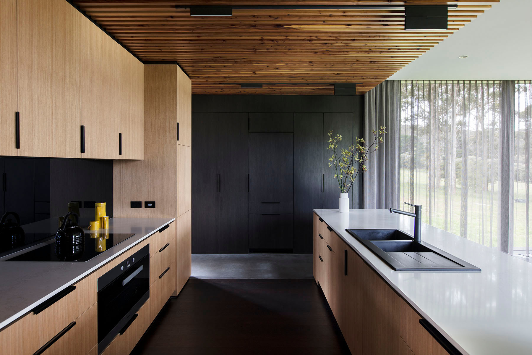 kitchen showing light timber cabinetry and timber battoned ceiling