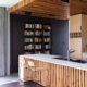 kitchen with vertical timber batons and timber stools