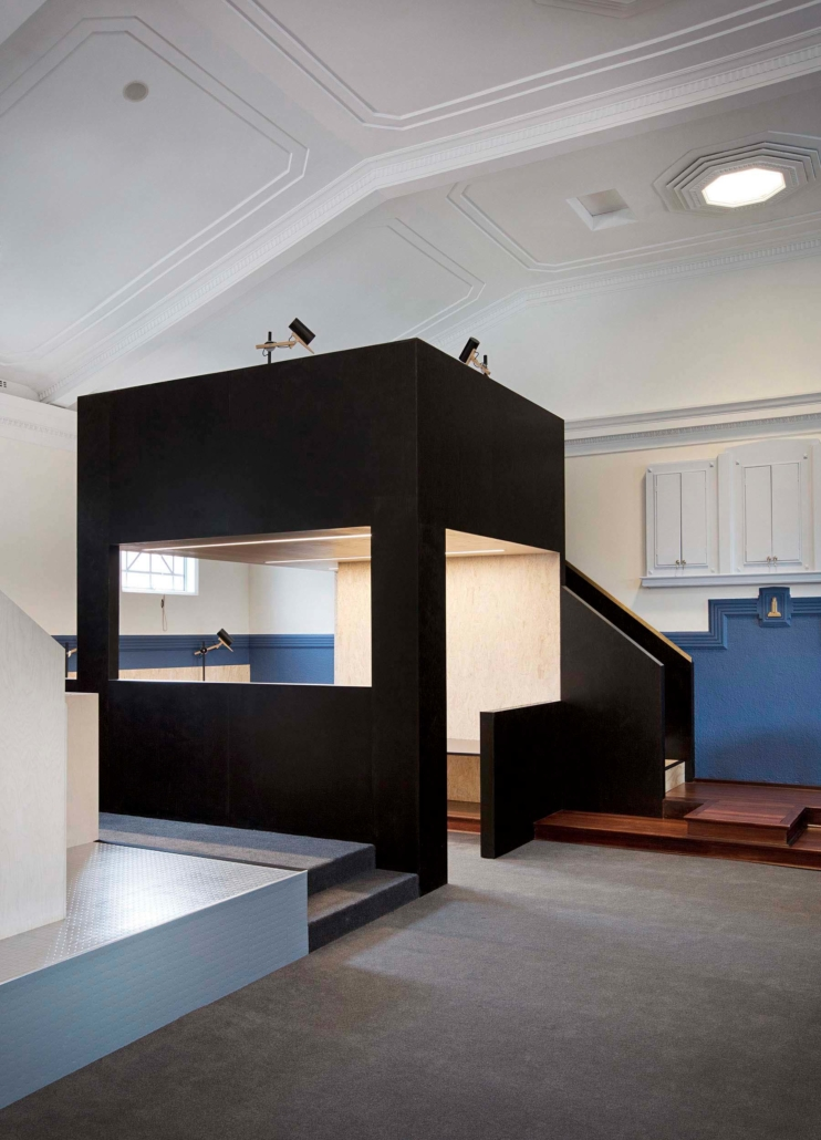 renovation insude a heritage building with large balck box style as a room