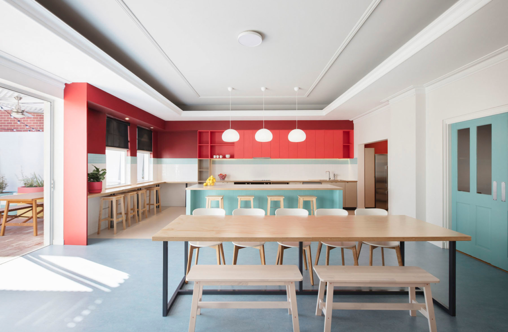 large room with kitchen and dining area in bright colours