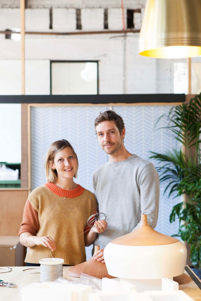 portrait of two people in their design studio