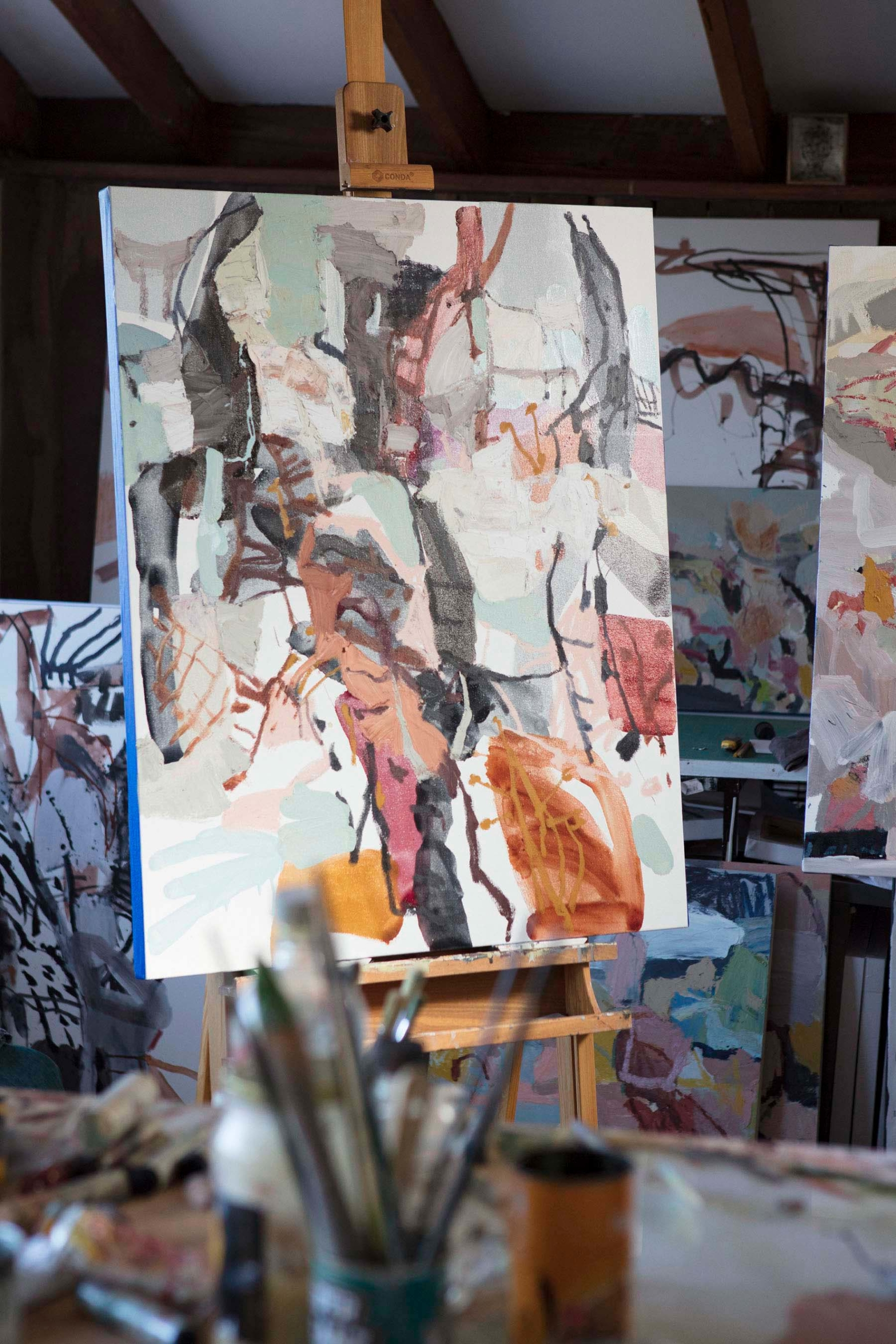 abstract artwork on an easel inside an artists studio